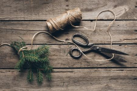 fir branch, twine and scissors
