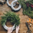 Florist making Christmas wreath