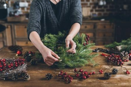 decorator making Christmas wreath