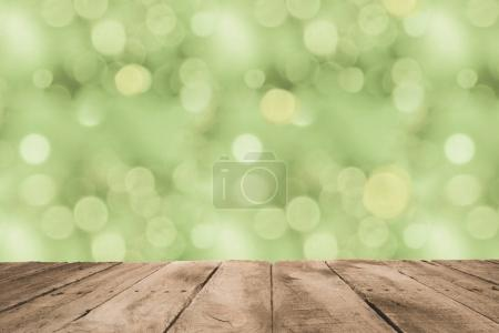 Photo for Grunge wooden planks surface with green blurry background - Royalty Free Image