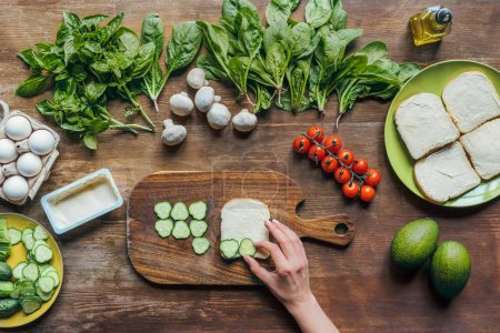 woman making toasts for breakfast