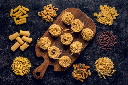 Photo for Flat lay composition of various raw pasta - Royalty Free Image