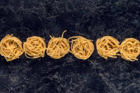 pasta nests in row