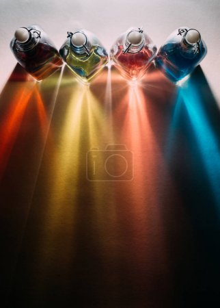 Rainbow shadows from glass bottles
