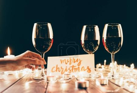 Red wine and merry christmas card