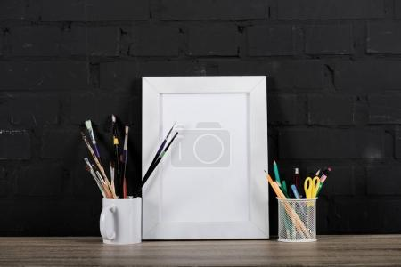 photo frame and office supplies on table