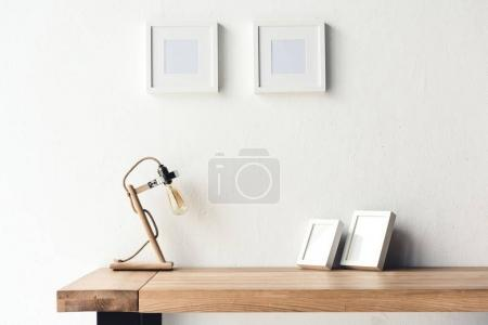 photo frames hanging on wall at workplace