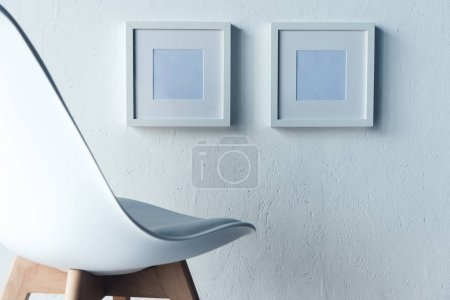 empty photo frames hanging on wall