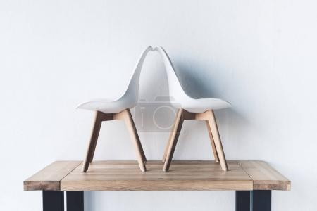 Photo for Close up view of modern chairs on wooden tabletop - Royalty Free Image
