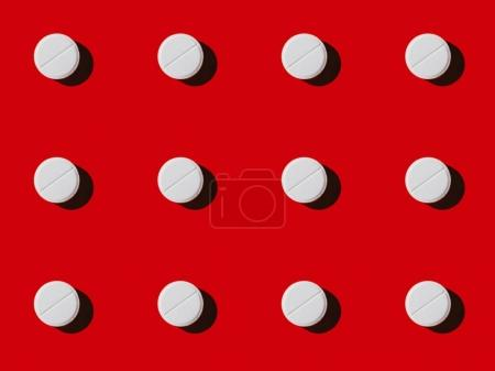 Photo for Close-up view of pattern made from white vitamins on red - Royalty Free Image