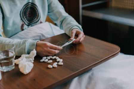 sick person taking medicine