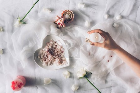Woman hand with white candle