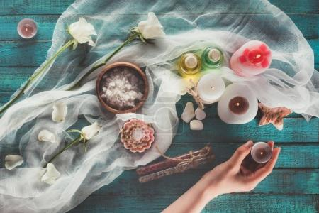 Woman making spa treatment decoration