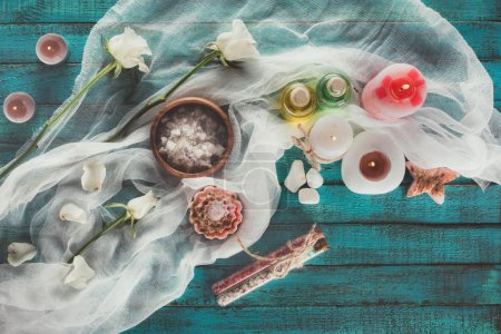Photo for Top view of spa treatment with decoration on turquoise surface - Royalty Free Image