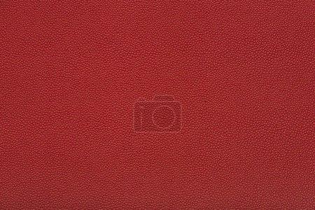 Photo pour Bouchent la vue de la texture du tissu en cuir rouge - image libre de droit