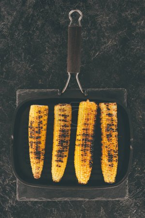 grilled corn on frying pan
