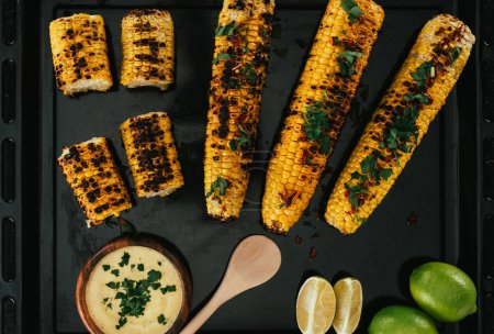 grilled corn on with sauce