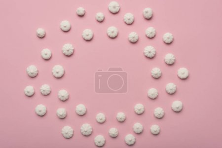 Photo for Circle frame made of white and berry marshmallows, isolated on pink - Royalty Free Image