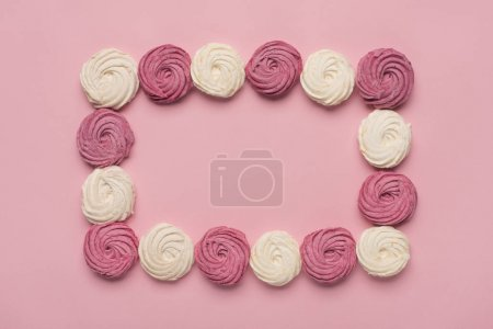 Photo for Frame made of white and berry marshmallows, isolated on pink - Royalty Free Image