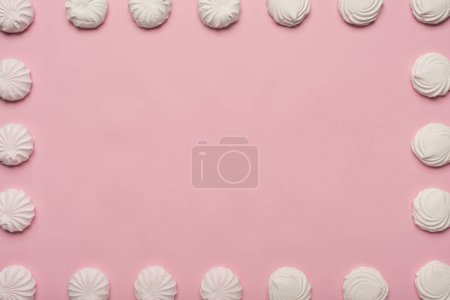 Photo for Frame made of white marshmallows, isolated on pink - Royalty Free Image