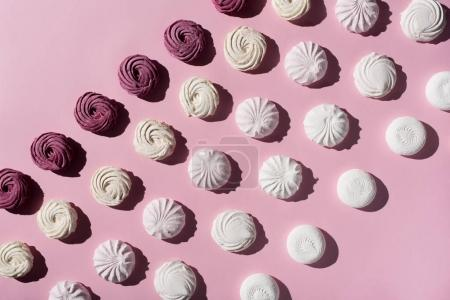 Photo for Pattern with berry and white marshmallows on pink surface - Royalty Free Image