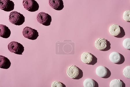 Photo for Berry and white marshmallows on pink surface with copy space - Royalty Free Image