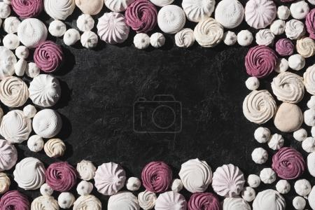 Frame of berry and white marshmallows