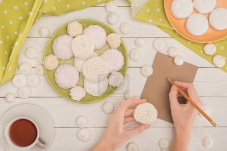 woman with marshmallows and tea