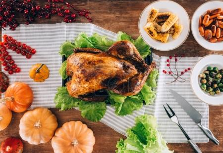Baked turkey in middle of served table