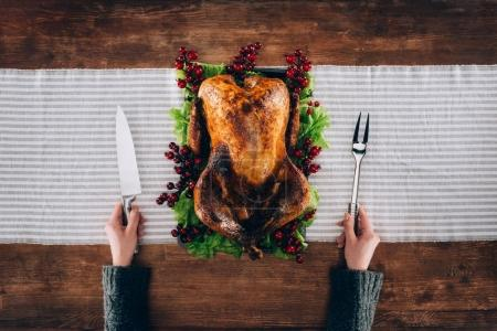 Man preparing cut baked turkey
