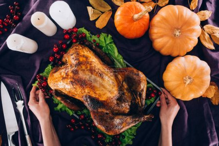 Man serving turkey for thanksgiving day