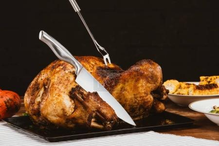 Baked turkey with fork and knife