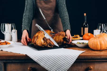 Cook standing with turkey on thanksgiving day