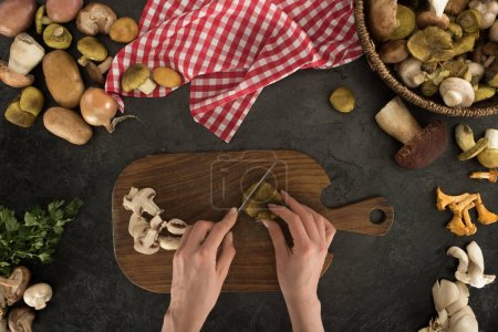 woman cutting mushrooms into peaces