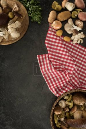 Photo for Top view of mushrooms and vegetables on a concrete surface - Royalty Free Image