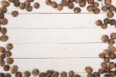 "Постер, картина, фотообои ""грецкие орехи на деревянном столе"""