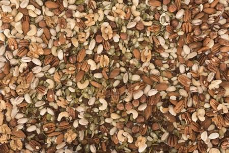 Photo for Top view of assorted healthy dried nuts background - Royalty Free Image