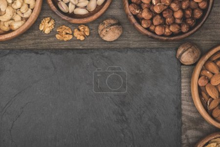 nuts in bowls and slate board