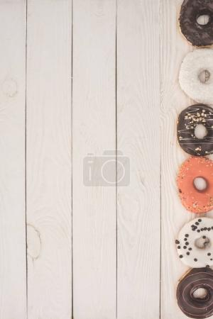 donuts on wooden table top