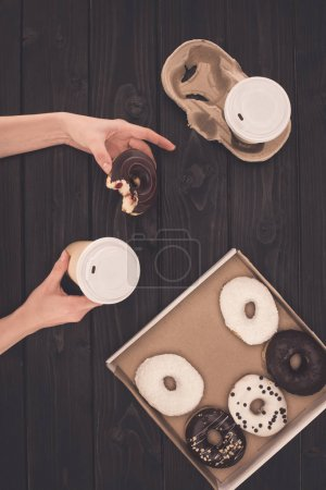coffee and donut in hands