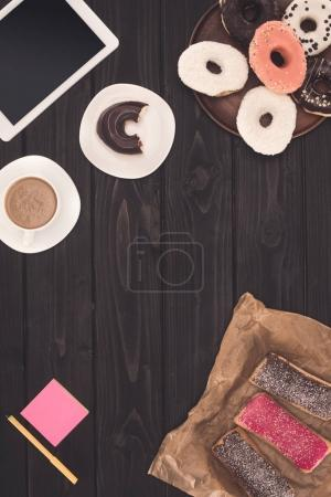 doughnuts, coffee and digital tablet