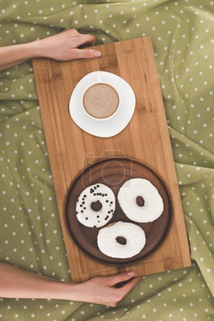 doughnuts and coffee on tray