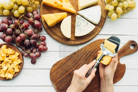 Woman cutting cheese