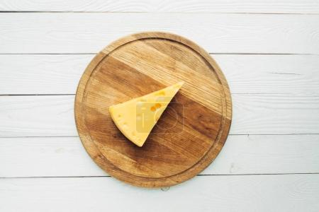 piece of cheese on cutting board