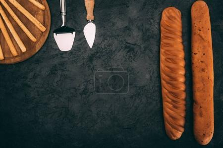 Cutlery and various types of bread