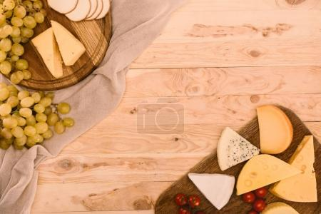 various types of cheese on cutting boards
