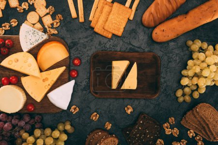 various cheese types, bread and grapes