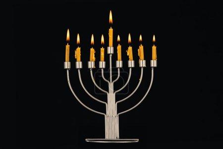 hanukkah celebration with menorah and candles