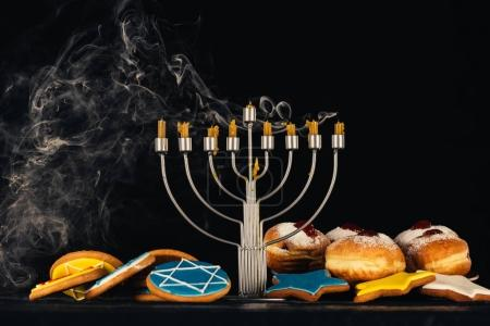 menorah and sweets for hanukkah celebration