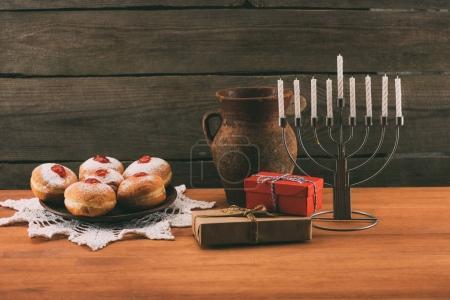 Menorah, gifts and donuts for hanukkah